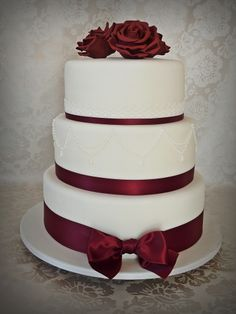 - Tiers are 8-10-12 inches, fondant covered cake with gumpaste roses and RI piping. Lace ribbon is real. I have trouble to get the right bordeaux color, want it to be a young red wine but it always turns out very matured and brownish. How do you mix it? I use Americolor gel paste colors. Roses are made with regular round cutter, I thin out the edges and let the leaves dry a bit on spoons before adding them with tylo glue.