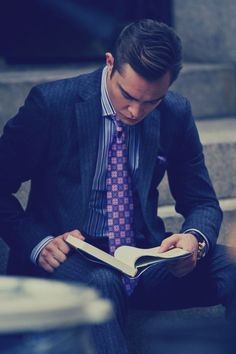 "Ed Westwick between takes on the set of Season 6 of Gossip Girl reading ""A Farewell to Arms"" by Ernest Hemingway."