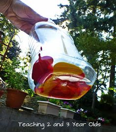 """Mixing colours inside a bottle with marbles - from Teaching 2 and 3 Year Olds ("""",)"""