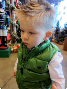 toddler boy with green vest toy soldier | Raddest Men's Fashion Looks On The Internet: http://www.raddestlooks.org                                                                                                                                                      More