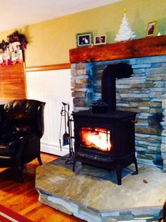 Wood burning stove fireplace mantle from barn beam