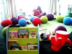 Children's Libraries are also full of toys, pillows and color. These often disappear in the transition to adult libraries.