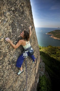 A woman climbing in