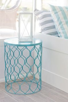 spray-painted wire trash can, upside-down = side table
