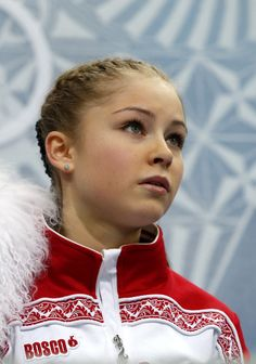 Russia's Julia Lipnitskaia waits for her marks in the Kiss and Cry zone after performing in the Women's Figure Skating Short Program at the Iceberg Skating Palace during the Sochi Winter Olympics on February 19, 2014. AFP PHOTO / ADRIAN DENNIS (Photo credit should read ADRIAN DENNIS/AFP/Getty Images)