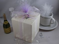 Ivory Silk Daisy Top Favour box with ivory & lilac organza ribbon, lilac tea rose & lilac feather