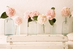 Vintage glass vases with pink roses.