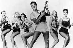 Blue Hawaii publicity shot: Left to right: Pamela Austin, Darlene Tompkins, Joan Blackman, Elvis Presley, Jenny Maxwell, Kay Christian, in a publicity photo for Blue Hawaii (1961).