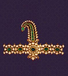 Sarpech - An impressive turban ornament studded with emeralds and diamonds.