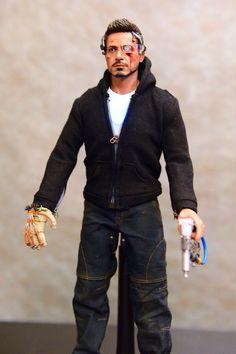 Tony in his hoodie and makeshift stun glove and nail gun