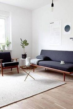 How to Make a Small Living Room Look Bigger||hits on size and placement of rugs