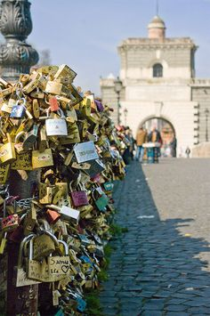 So Romantic, couples put padlocks on Ponte Milvio bridge in Rome, Italy. You lock it and throw away the key in the water below!