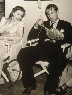 "Barbara Stanwyck helping  Gary Cooper with his knitting  on the set of ""Ball of Fire"" (1941)"