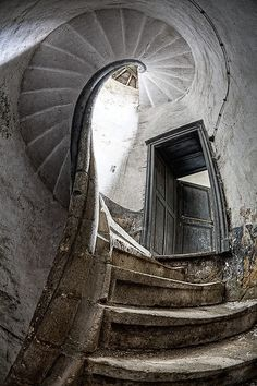 Spiral staircase in an abandoned  castle in #Castles