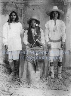 Apache men, one playing Apache violin, San Carlos Reservation, Arizona, C.1880