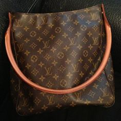 Antique authentic Louis Vuitton hobo handle bag Guarantee antique LV handbag from my aunt - very good condition! More picture available. Louis Vuitton Bags Hobos