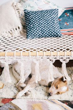 "A foldable wooden frame cot with cotton macramé rope seating and tassels! For inside use* 7' x 38"" x 18"" tall"