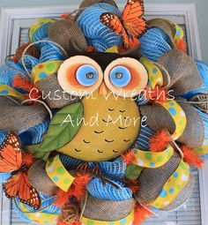 This adorable wreath is blue mesh, accented with yellow burlap, rope , green polka dot burlap ribbon, and finished with a super cute owl. All wired in never hot glued. Just in time adorable spring wreath. owl wreath, owl mesh wreath, spring wreath, spring owl door decor etc