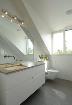 Like sink/bench top, like tiles, like vanity, like floating toilet