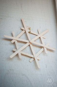 Dwell Beautiful makes some easy popsicle stick snowflakes that make for great, fun, and cheap winter decor. A great craft for kids to get in on and help out with!