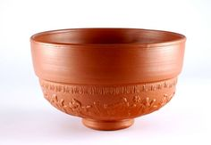 A large terracotta Roman bowl with images of people embossed around the base © Leeds Museums and Galleries