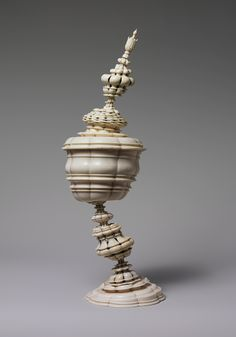A turned ivory cup from Germany ~ 17th century. Its whimsical form and hollowed out stem make it a complex masterpiece.