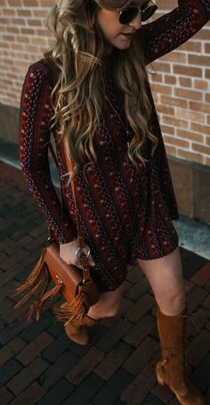 Spring boho outfit with tribal print long sleeve swing dress, lace up suede boots, and fringe crossbody bag #bohochic #suedeboots #bohooutfit #springoutfit #fringebag
