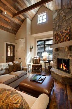 The Chic Technique Country Living Room With Glass Panel Door Carlisle Leather Ottoman Exposed Beam Stone Fireplace Wood Paneled Ceiling