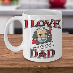 Funny Fathers Day Gift For Dad I love that you are my Dad *11oz Mug  *Same Print on each side  *Dishwasher and microwave safe Ceramic Mug  *Your Coffee Cup will be Printed and shipped from the USA  *The highest quality printing possible is used. Your Ceramic Mug will never fade no matter how many times you wash it.