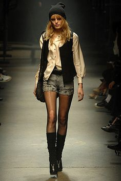Love the top portion but I'm getting a bit too old for the tights under short shorts look.