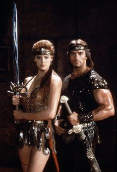 Danish actress/model/singer Brigitte Nielsen as Red Sonja and Austrian Arnold Schwarzenegger as Lord Kalidor in Red Sonja Barbarian Movie, Conan The Barbarian, Danish Actresses, Actors & Actresses, Red Sonja Movie, Conan Der Barbar, Brigitte Nielsen, Conan The Destroyer, Sword And Sorcery