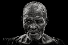 I'm serious - An older man from the village of Porto Alegre in Sao Tome.