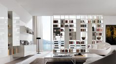 I can't imagine wanting to block THAT view, but...Bookshelves Furniture-Total Home Interior Design and Solutions by Zalf Mobili