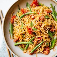 This simple vegetable chow mein is stir fried with ripe tomatoes and crisp green beans. The noodles are also seasoned with cumin to give the noodles richer flavor. Ready in less than 30 minutes! Veggie Recipes, Asian Recipes, Healthy Dinner Recipes, Vegetarian Recipes, Ethnic Recipes, Veggie Dinners, Diner Recipes, Vegetarian Options, Asian Foods