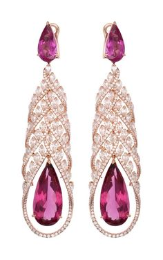Celebrating coloured gemstones this week - nothing beats @chopard Red Carpet collection #rubellite #earrings surrounded by #diamonds. Melting in romance #Chopard #highjewellery #luxury