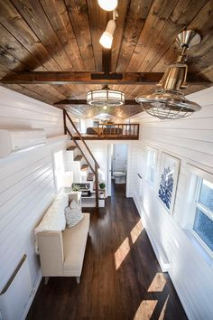 There is a large bedroom loft on each end of the tiny house, one with stair access and the other with ladder access. The lofts are large enough for a king bed and dresser/storage area.