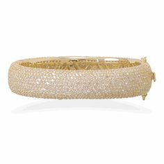 This elegant .925 Sterling Silver bangle bracelet has a 14K Gold plated finish. This bracelet also has 1,357 individually set Cubic Zirconia stones. The inside of the bracelet has a polished cut ou...