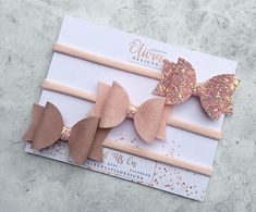 Trio blush set of 100% wool felt, chunky glitter and leatherette fabric. These are small bows and they come on either a no-teeth aligator hair clip or blush nylon headband. Our nylon headbands are super soft and one size fits all. Small bow measures approx. 2.5inches long from