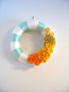 I chose grey and mustard for winter, but also super easy.  The yarn wrapping takes a while and it is hard to ensure the color transition is smooth, I suggest always switching colors on the backside of the wreath.