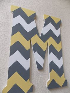 Hand painted wooden letter with chevron pattern. $50.00, via Etsy.