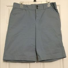 """Slate blue Dockers shorts. Stretchy! Size 12 Dockers Bermuda shorts in slate blue. Elastic inside waistband and some stretch in the shorts. Size 12. 60% cotton, 37% poly, 3% spandex. 11"""" inseam. 2 button at close. Dockers Shorts Bermudas"""