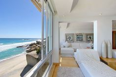 The Heron - Living room and beach views - Nox Rentals Cape Town holiday rental property