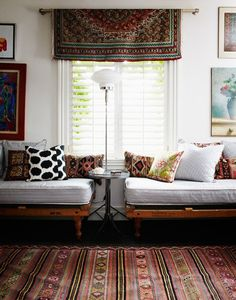 Love the way the floor rug, kilim cushions and window hanging come together. Also good mix of print textiles on cushions.