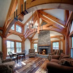 Crafted in partnership with Kenneth Vona Construction, this New England great room features curved bottom chord trusses with hand oiled metal strapping. Photo by Ed Wonsek.