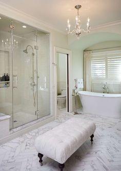 Elegant bathroom design with stand alone tub, glass door shower and chandelier | Francesca Owings Interior Design