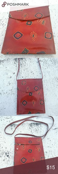 Vintage African Print Purse NEW LISTING! - Vintage African print purse in faux leather .. Strap length measures 26 inches .. Purse opens with flap enclosure .. Inside, double pockets allow for nice room for storage .. Zip flap encloser on the back perfect to additional small items .. Bag is  NWOT ... New / NEVER worn. Bags Crossbody Bags