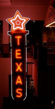 TEXAS Neon Sign from the Texas Theater, Sherman, Texas. Formerly owned by Howard Hughes, the sign is now at the Bullock Texas State History Museum, Austin, Texas.