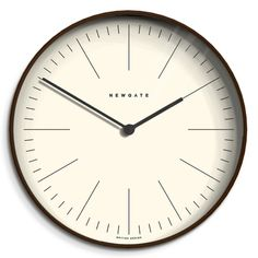 The Mr Clarke wall clock in dark plywood by Newgate Clocks. Contemporary dark plywood is paired with a linear marker dial to create a modern minimalist wall clock. Iconic British design   www.newgateclocks.com #homeware #decor #interior #homeaccesory