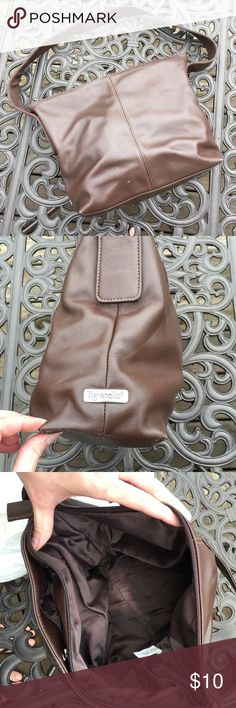 Tignanello brown faux leather shoulder bag Brown shoulder bag being sold in used condition.  Lots of use left in this bag, no tears or holes and strap is in good condition.  There are a few small discolorations (see 4th pic) corners ahow some wear and liner is also slightly discolored.  Priced accordingly. Tignanello Bags Shoulder Bags