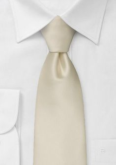 Solid color neckties Champagne color tie   A popular necktie for weddings at an unbelievable low price. This solid color tie is made from a care-free microfiber fabric, that is more stain resistant, but almost indistinguishable from our pure silk ties.